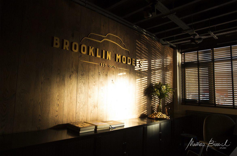 bold logo design yellow dark wood panels