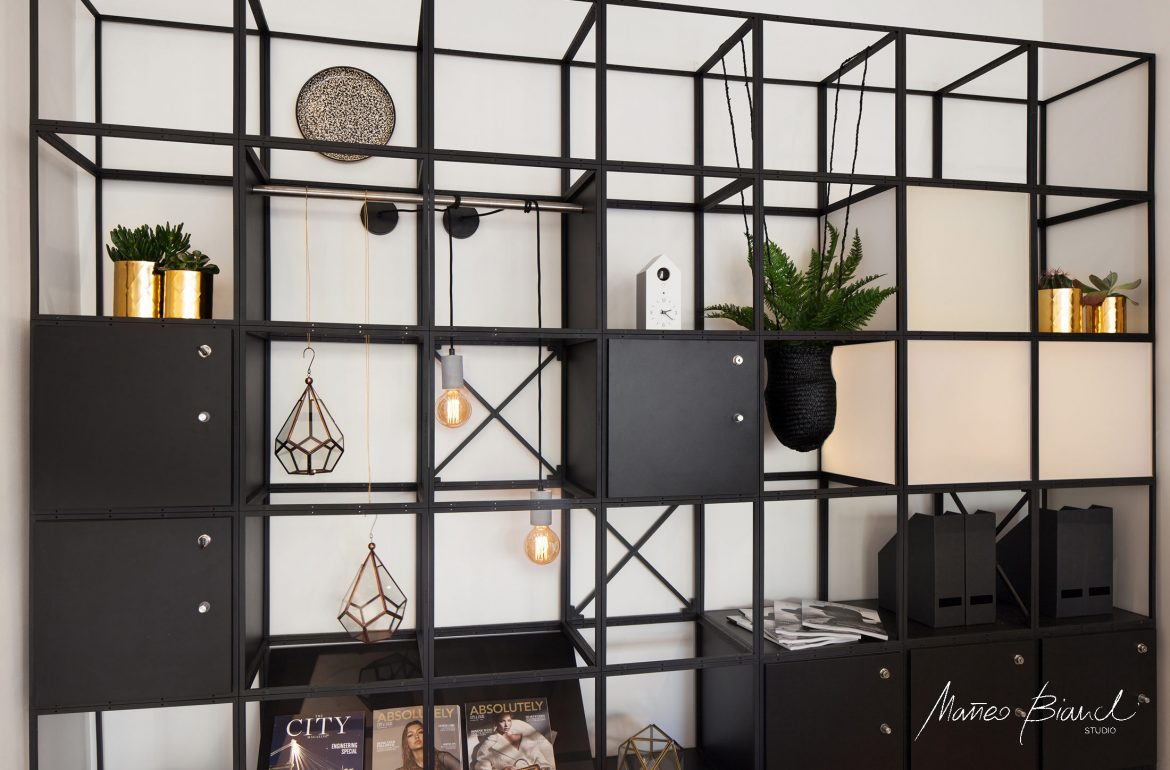 contemporary black library gold back lighted design