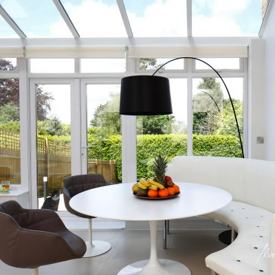 bright kitchen round table sofa Castiglioni black lamp