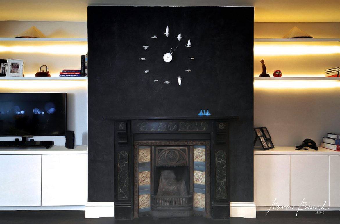 black fire place wall bird watch design