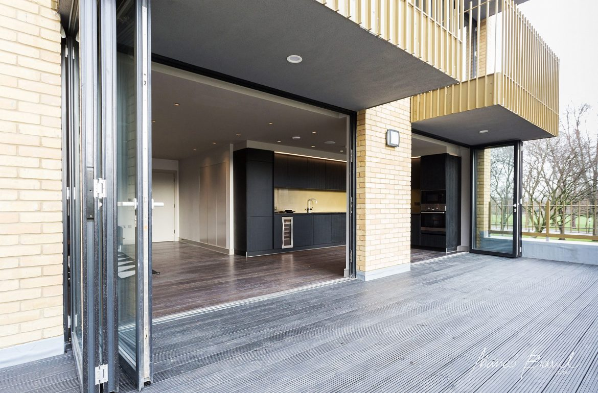 black kitchen deck fully glass open facade design