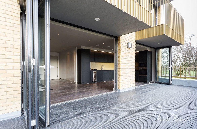 black kitchen deck fully glass open facade design