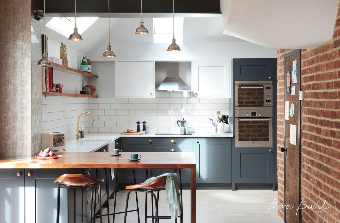 Muswell Hill teal kitchen design vintage lights