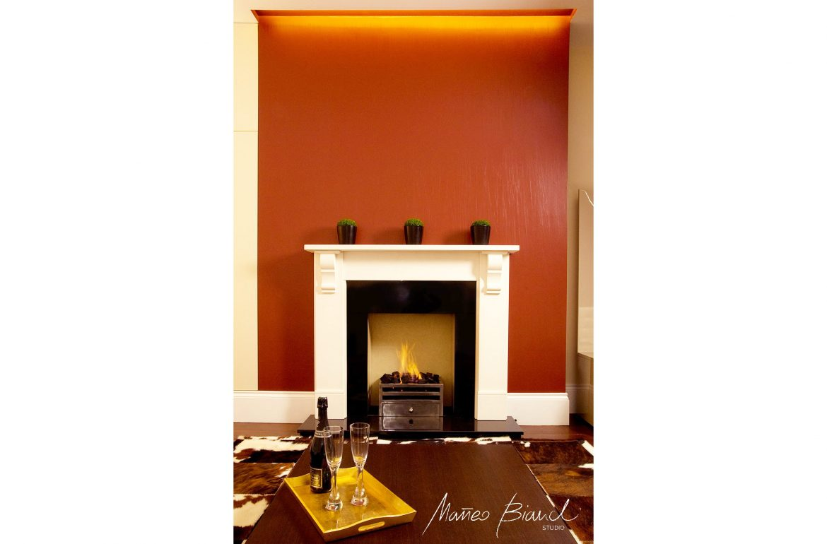 orange fire-place interior Chelsea London