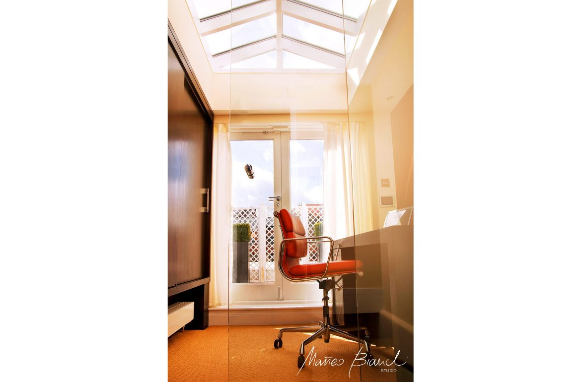 glass roof studio office red chair design